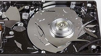 Hard disk drive platter - Destroyed hard disk, glass platter visible