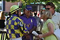 Trainer Manuel Berrios chats with Pedro Cotto Jr. and company before a race (6067528883).jpg