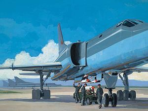 Tupolev Tu-22M - A painting depicting the loading of Raduga Kh-15 missiles on a Tu-22M rotary launcher. The bomber depicted is an early Tu-22M2, with distinctive air intakes.