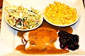 Turkey with gravy and cranberry sauce, with side dishes of creamed corn and coleslaw.jpg