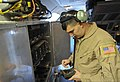 U.S. Air Force Airman 1st Class Daniel Deas, a radio operator with the 968th Expeditionary Airborne Air Control Squadron, puts information in the on-board communications system Nov. 16, 2013, at an undisclosed 131116-F-AB304-033.jpg