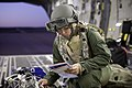 U.S. Air Force Capt. Danielle Cooper, a flight nurse with the 43rd Aeromedical Evacuation Squadron, inspects medical equipment aboard a C-17 Globemaster III aircraft prior to departing Fort Polk, La., during 140117-F-RW714-631.jpg