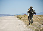 U.S. Army Sgt. 1st Class Jonathan Bradford, with the 3rd Brigade Combat Team, 82nd Airborne Division, conducts a runway inspection during a joint forcible entry exercise May 31, 2013, at the Nevada Test 130531-F-UJ108-002.jpg