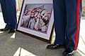 U.S. Marines stand at attention next to a picture during the memorial service for Laura Froehlich at the Riverside National Cemetery in Riverside, Calif., Aug. 10, 2012 120810-F-YU985-094.jpg