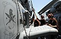 U.S. Sailors wash an MH-60R Seahawk helicopter assigned to Helicopter Maritime Strike Squadron (HSM) 70 aboard the aircraft carrier USS George H.W. Bush (CVN 77) in the Persian Gulf June 26, 2014 140626-N-MU440-014.jpg