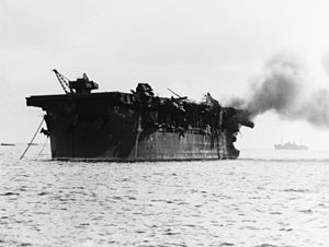 USS Independence (CVL-22) - USS Independence is on fire aft following the Operation Crossroads shot Able atomic bomb test, 1 July 1946