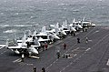 US Navy 020924-N-2385R-003 F-A-18 'Hornet' and 'Super Hornet' strike fighters stand ready on the ship's forward flight deck.jpg
