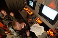 US Navy 030509-N-6501M-016 Aviation Warfare Systems Operators 2nd Class Matthew L. Delahunt and Theresa R. Donahue monitor video displays of the Sensor One and Sensor Two stations aboard a P-3C Orion aircraft.jpg