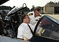 US Navy 030820-N-4294K-006 Commanding Officer, Naval Air Station (NAS) Oceana, Capt. T.F. Keeley briefs Virginia's Lt. Governor, Tim Kaine, on the cockpit of an F-14 Tomcat.jpg