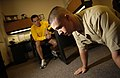 US Navy 031112-N-5862D-006 At Officer Candidate School (OCS) onboard NAS Pensacola, Chief Aviation Machinist Mate Jorge Ouiroz gives Officer Candidate Jason Roseberry some time to think in the lean and rest position.jpg