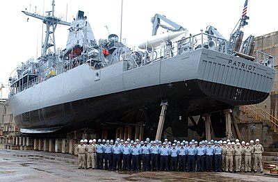 US Navy 040520-N-2420K-001 The crew of mine countermeasures ship USS Patriot (MCM 7) poses for a command photo during a dry dock maintenance period.jpg