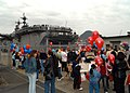 US Navy 050406-N-2716P-006 Friends and family await their Sailors and Marines to disembark at the homecoming celebration of the amphibious assault ship USS Essex (LHD 2).jpg