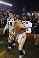 US Navy 051203-N-0295M-582 U.S. Naval Academy Midshipman and game MVP, Lamar Owens of Savannah, Ga. carries the Secretary Trophy to their locker room.jpg