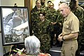 US Navy 060324-N-5911S-015 The Commanding Officer of Survival, Evasion, Resistance and Escape (SERE) School, Capt. Jim J. Gillcrist, presents a photo collage to Mrs. Sybil Stockdale in honor of her late husband, Vice Adm. James.jpg