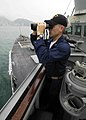 US Navy 060409-N-7981E-033 Ltj.g. Jeff Dennison monitors surface contacts in Hong Kong Harbor from the bridge of the guided missile destroyer USS Shoup (DDG 86).jpg