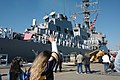 US Navy 060502-N-7987M-354 Family and friends of Sailors aboard guided-missile destroyer USS McFaul (DDG 74) wave good-bye as McFaul pulls away from pier at Naval Station Norfolk.jpg