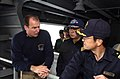 US Navy 070316-N-9712C-002 Lt. Cmdr. Cletis Strausbaugh, assigned to Nimitz-class aircraft carrier USS Ronald Reagan (CVN 76), explains the details of a refueling station to Japan Maritime Self Defense Force (JMSDF) Commander,.jpg