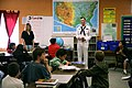 US Navy 070320-N-3271W-003 Electronics Technician 3rd Class Corey Field, assigned to fast attack submarine USS Tucson (SSN 770), talks with kids at Erickson Elementary School about life on a submarine.jpg