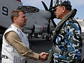 US Navy 070406-N-5345W-006 Commander, Carrier Strike Group (CSG) 10 Rear Adm. William Gortney welcomes Chinese People's Liberation Army Navy (PLAN) Vice Adm. Wu Shengli after arriving aboard the Nimitz-class aircraft carrier US.jpg