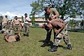 US Navy 070828-N-0989H-192 Marine Corps Staff Sgt. Oscar Cruz, assigned to a U.S. Marine Corps Training Team, assists a member of the Belize Defense Force with executing the proper steps for a controlled fall during small unit.jpg