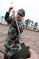 US Navy 071127-N-1057H-708 Utilitiesman 2nd Class Jeffery Napier attaches antennae probes to the feed horn of an OE-254-GRC antennae during the Naval Mobile Construction Battalion (NMCB) 11 communications exercise (COMMEX).jpg
