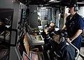 US Navy 080126-N-7981E-825 Sonar Technician (Surface) 1st Class Mark Osborne supervises Sonar Technician (Surface) 2nd Class Randy Loewen, right, and Sonar Technician (Surface) 3rd Class Roland Stout, left, as they monitor cont.jpg