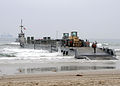 US Navy 080706-N-1424C-975 Cargo and equipment is offloaded from an improved Navy lighterage system causeway ferry.jpg