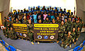 US Navy 090302-N-7367K-002 Children and staff of Gulfport Central Middle School and West Elementary School stand with Seabees.jpg