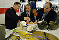 US Navy 090505-N-7676W-066 William Pogue, right, and Dave Horner, engineers at the Multi-functional Materials Branch of the Naval Research Laboratory, explain the brain surrogate system to Vice Adm. David J. Venlet, commander,.jpg