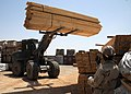US Navy 090527-N-8547M-107 Construction Electrician 3rd Class Olatunde Lawal, assigned to Naval Mobile Construction Battalion (NMCB) 5, directs Utilitiesman 3rd Class Patrick Krupa as he drives a forklift.jpg