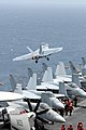 US Navy 090707-N-3610L-087 An F-A-18F Super Hornet, assigned to the Fighting Redcocks from Strike Fighter Squadron (VFA) 22, launches off the flight deck of the aircraft carrier USS Ronald Reagan (CVN 76).jpg