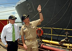 US Navy 090815-N-2147L-001 Cmdr. Curt Jones, right, commanding officer of the San Antonio-class amphibious transport dock ship Pre-Commissioning Unit (PCU) New York (LPD 21), briefs New York Jets owner Woody Johnson before givi.jpg