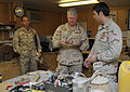 US Navy 100109-N-8273J-238 Chief of Naval Operations (CNO) Adm. Gary Roughead is shown examples of improvised explosive device initiators.jpg