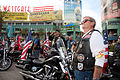 US Navy 100325-N-3271W-053 Members of the Patriot Guard Riders, a motorcycle group dedicated to supporting American service members, pause for the national anthem, sung by the U.S. Navy Band Southwest Destroyers.jpg