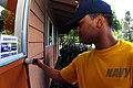 US Navy 100408-N-0995C-024 Electrician's Mate Fireman Tomas Barnes paints the outside of the Hilo Girl Scout Service Center during a community service project.jpg