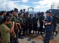US Navy 100714-N-9706M-214 Lt. j.g. Rebecca Conti-Vock talks to cadets from Feydhoo High School in the Maldives.jpg