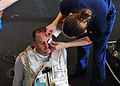 US Navy 100815-N-0593C-007 Aviation Structural Mechanic 1st Class Paul G. Winkler is treated for a simulated eye injury during a mass casualty exercise aboard USS Enterprise (CVN 65).jpg
