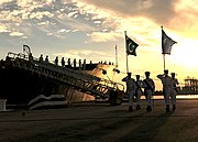 US Navy 100831-N-8590G-005 Pakistan sailors parade their country's colors during the decommissioning ceremony of USS McInerney (FFG 8) at Naval Station Mayport