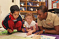 US Navy 101109-N-8102J-117 Aviation Structural Mechanic Airman Tamara Mitchell, assigned to Helicopter Maritime Strike Squadron (HSM) 40, reads wit.jpg