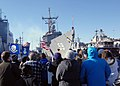US Navy 101223-N-5292M-080 Family and friends cheer as the guided-missile frigate USS Kauffman (FFG 59) returns to Naval Station Norfolk after a si.jpg