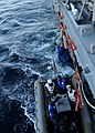 US Navy 110120-N-4322G-291 Boatswain's Mate Seaman Chyrel PoePoe climbs down a pilot's ladder from the guided-missile destroyer USS Sampson (DDG 10.jpg
