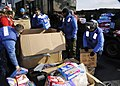 US Navy 110324-N-6692A-033 Sailors prepare relief supplies. Germantown is off the coast of Japan providing humanitarian assistance as directed in s.jpg