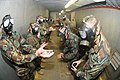 US Navy 110624-N-IL826-186 Seabees practice removing and replacing filters on the M-40A gas mask while in the confidence chamber.jpg
