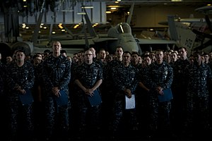 US Navy 111213-N-DR144-938 Newly promoted petty officers wait with their frocking letters.jpg
