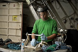 US Navy 120112-N-BT887-271 Aviation Support Equipment Technician Airman Devon Bryant, from Norfolk, cleans support equipment aboard the Nimitz-clas.jpg