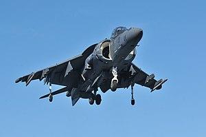 US Navy 120119-N-UM734-428 An AV-8B Harrier from Marine Attack Squadron (VMA) 542 flies over the amphibious assault ship USS Kearsarge (LHD 3).jpg