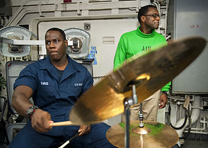 US Navy 120123-N-FI736-178 Personnel Specialist Seaman Dwayne Davis plays the drums during a Dr. Martin Luther King, Jr. birthday celebration aboar.jpg