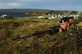 Ukrainian Naval Infantry - A Ukrainian naval infantryman armed with a Dragunov sniper rifle takes part in Exercise Northern Light '03 on the west coast of Scotland.