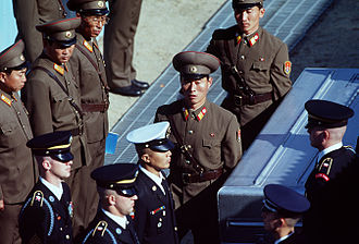 Joint POW/MIA Accounting Command - United Nations Command (UNC) honor guard members receive remains from Korean People's Army soldiers at the Joint Security Area Nov 6,1998
