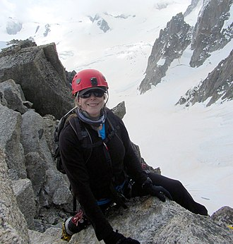 Vanessa O'Brien - Vanessa O'Brien sitting on a rock at the top of the Aiguille du Midi, Chamonix France.